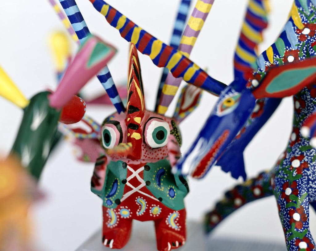 Alebrijes... colorful painted Mexican wooden animals