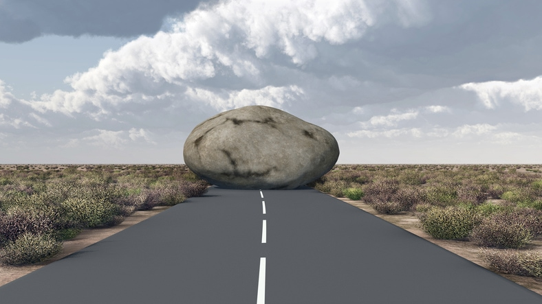 giant boulder blocking a road